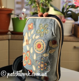Backpack with appliqué